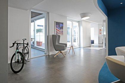 ARCA | Trestle-based armchair
