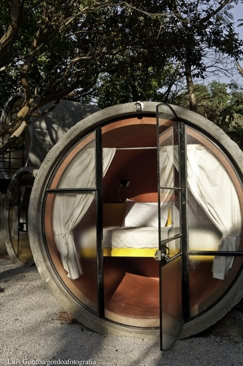 concrete pipes transformed into rooms create an unusual hotel