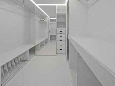 Aspa Arquitectos's black & white apartment expansion in Lisbon